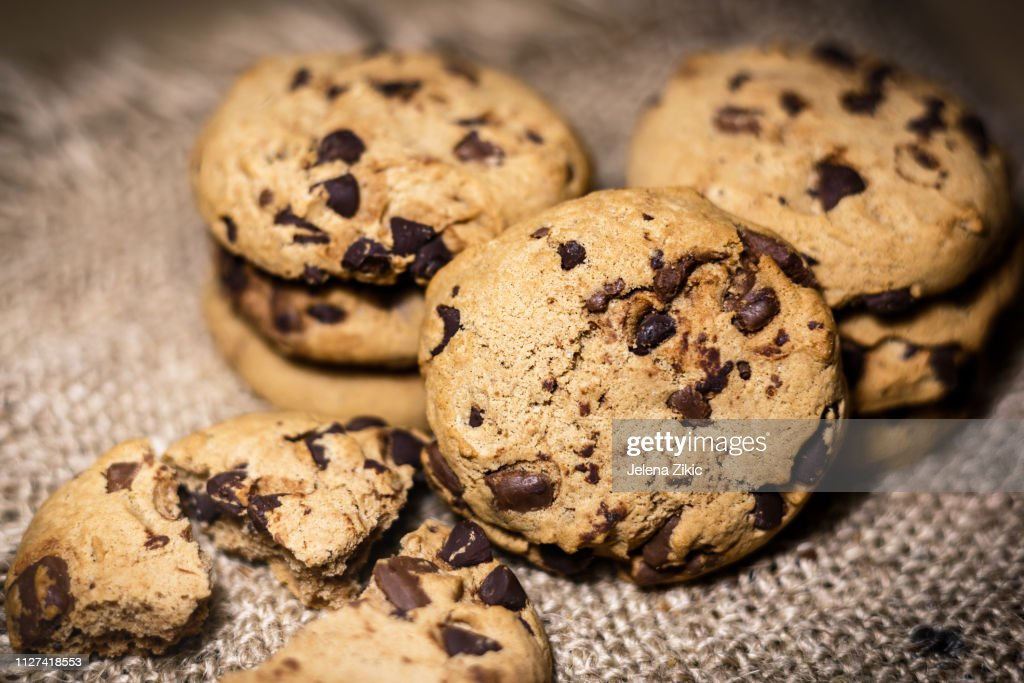 Chocolate chip cookies on rustic background : Stock Photo