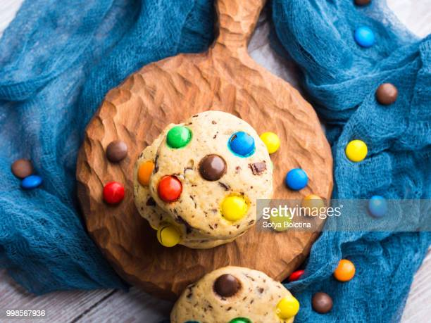 Chocolate chip cookies with colorful candies. Top view