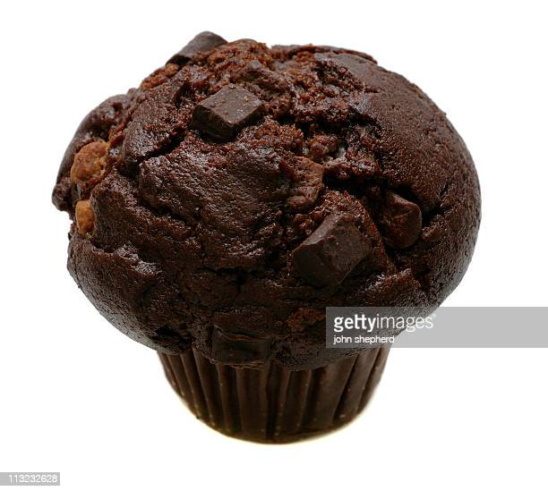 Chocolate chip Muffin isolated against white
