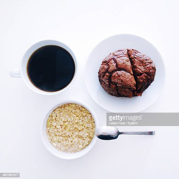 Chocolate Chip Muffin With Black Coffee And Oatmeal On Table