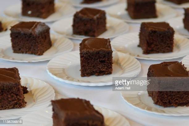 chocolate, chocolate cake refreshments on plates at wedding reception - utah wedding stock pictures, royalty-free photos & images
