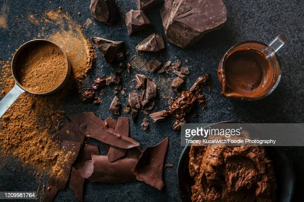 chocolate chunks, frosting and cocao - dark chocolate stock pictures, royalty-free photos & images