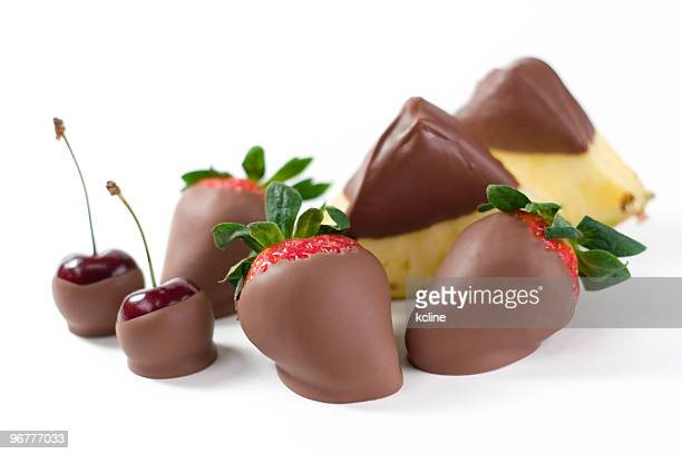 chocolate clad fruits - chocolate dipped stock pictures, royalty-free photos & images