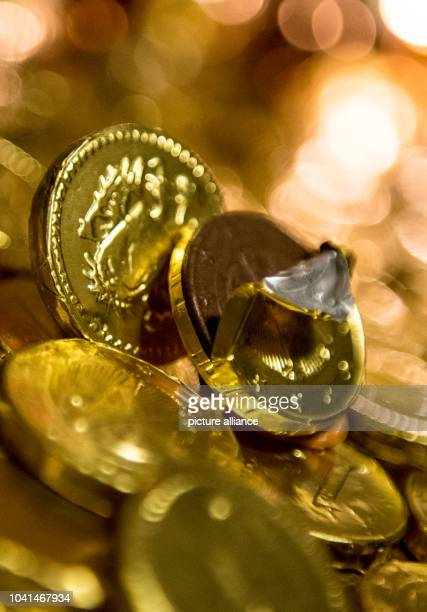 ILLUSTRATION  A chocolate coin has been partially unwrapped in Frankfurt am Main Germany 21 November 2015 In the early 19th century American...