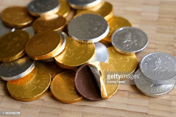 chocolate coins - chocolate stock pictures, royalty-free photos & images