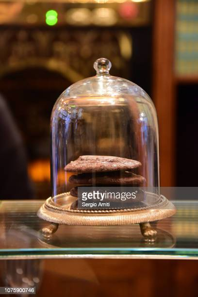 Chocolate cookies in a glass dome cover