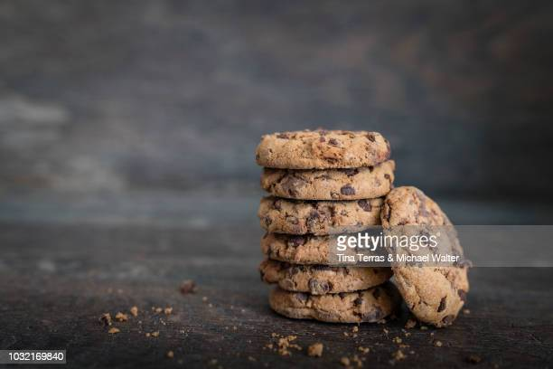 Chocolate cookies on rustic wooden background.