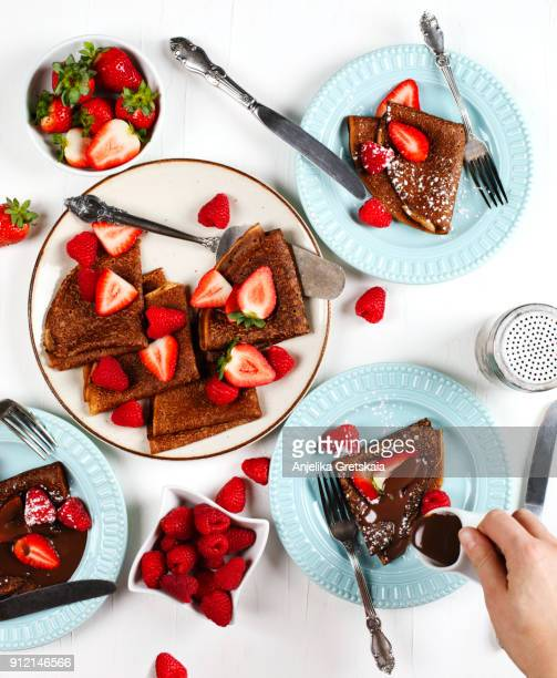 Chocolate crepes with berries and chocolate sauce