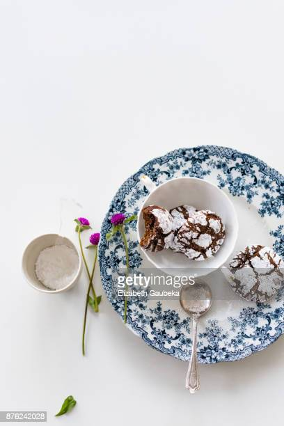 chocolate crinkle cookies in a white bowl and vintage blue plate - fudge stock pictures, royalty-free photos & images