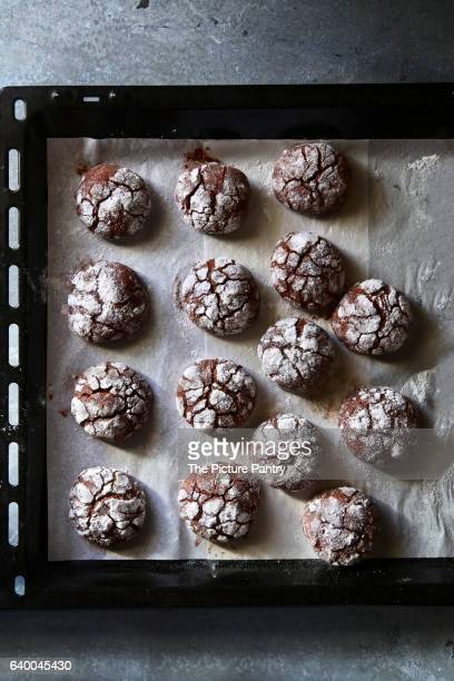 Chocolate crinkle cookies on tray.Top view