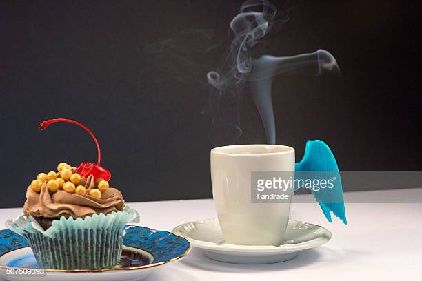 Chocolate cupcake and cup of coffee