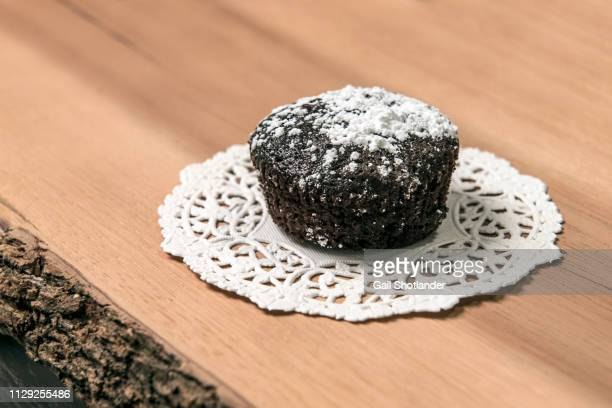 chocolate cupcake - doily stock photos and pictures