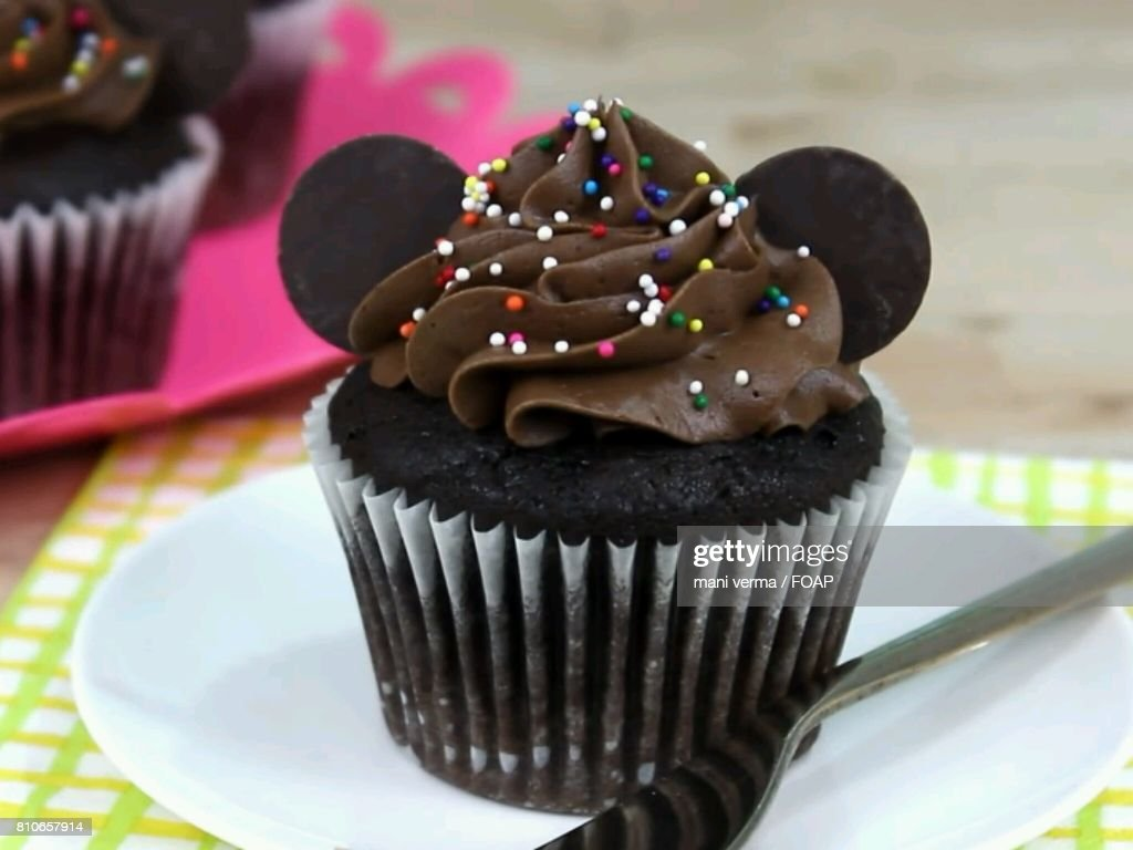 Chocolate Cupcake With Sprinkles Stock Photo - Getty Images