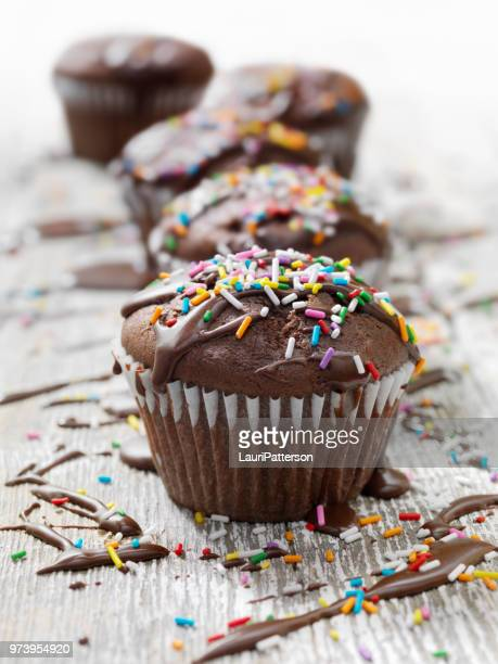 chocolate cupcakes with fudge icing and sprinkles - fudge stock pictures, royalty-free photos & images