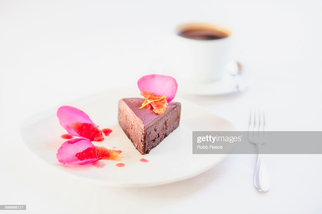 Chocolate dessert on plate with garnish and coffee, Grand Junction, Mesa County, Colorado, USA : Stock Photo