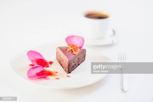 chocolate dessert on plate with garnish and coffee, grand junction, mesa county, colorado, usa - robb reece stockfoto's en -beelden