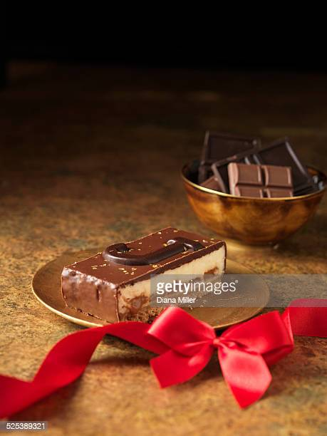 Chocolate dessert slice with letter J