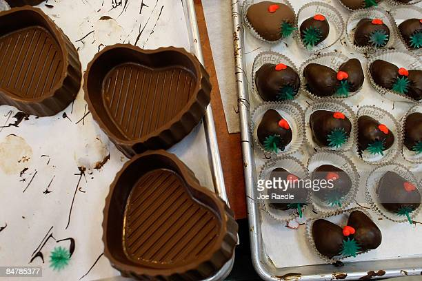Chocolate dipped strawberries and heart shapped chocolate boxes are ready to be purchased at Schakolad Chocolate Factory on February 13, 2009 in...