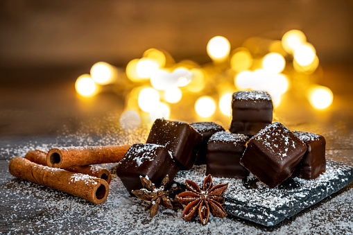 Chocolate dominos with icing sugar, cinnamon sticks. German specialty for Christmas - gettyimageskorea