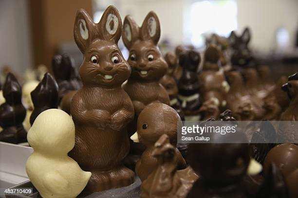 Chocolate Easter bunnies and other animals lie on a table prior to being packaged at the production facility at Confiserie Felicitas chocolates maker...