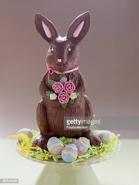 Chocolate Easter Bunny surrounded by Easter eggs