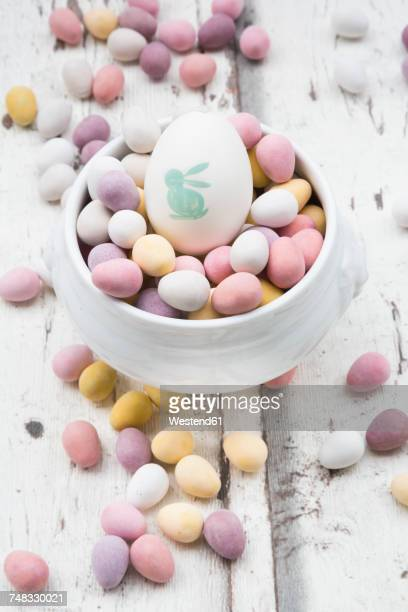 Chocolate Easter eggs and painted Easter egg in bowl