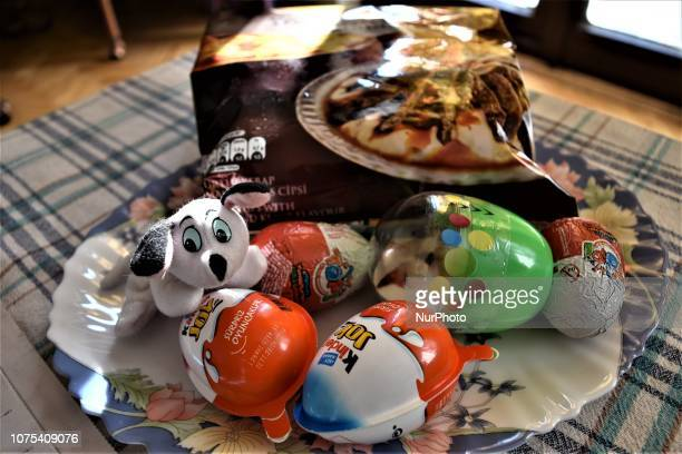 Chocolate eggs with surprise toys are seen in front of a package of potato chips in Ankara Turkey on December 28 2018 Turkey's Ministry of Trade...