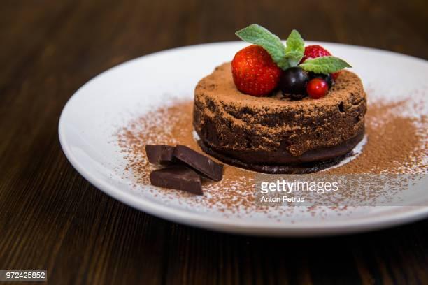 Chocolate fondant (lava cake) decorated with strawberries