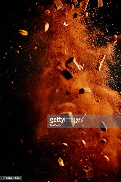 chocolate food explosion with cocoa powder, chocolate chips and nuts - spice stock pictures, royalty-free photos & images
