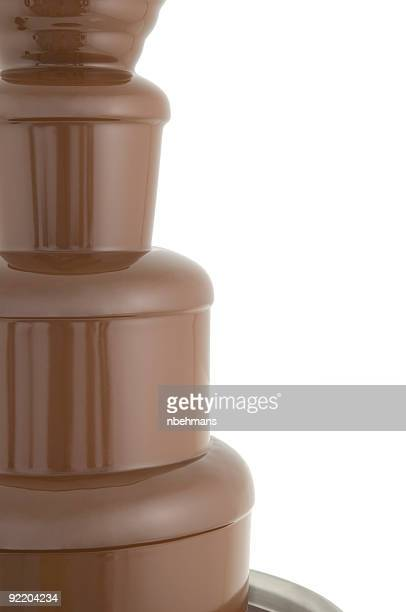 chocolate fountain flowing - milk fountain stock photos and pictures