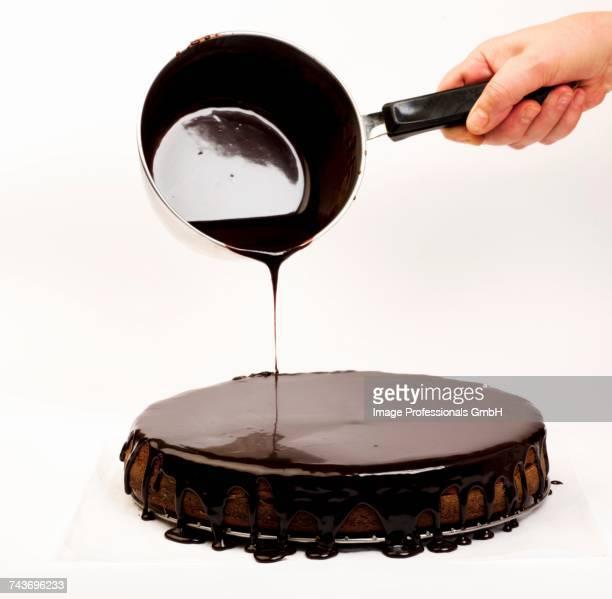 Chocolate glaze being poured over a Sachertorte