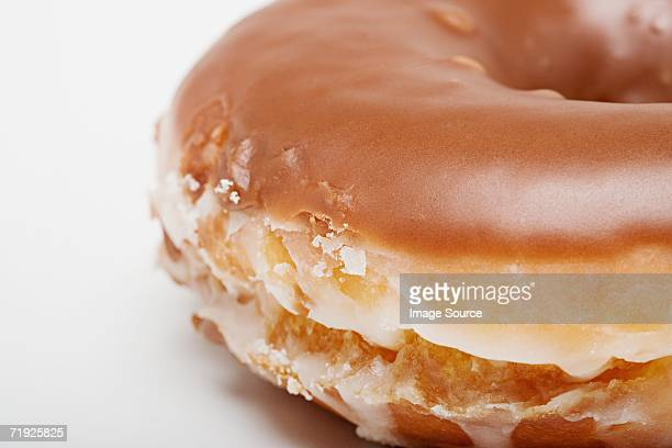 chocolate glazed doughnut - glazed food stock pictures, royalty-free photos & images