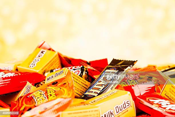 chocolate halloween candy - pile of candy stock photos and pictures