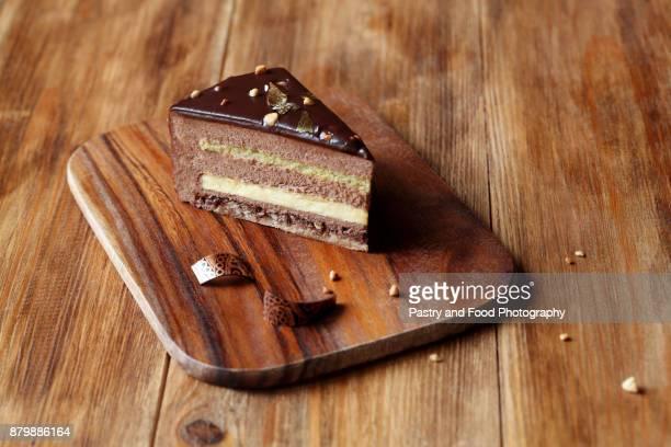 chocolate hazelnut mousse cake - cream cake stock pictures, royalty-free photos & images