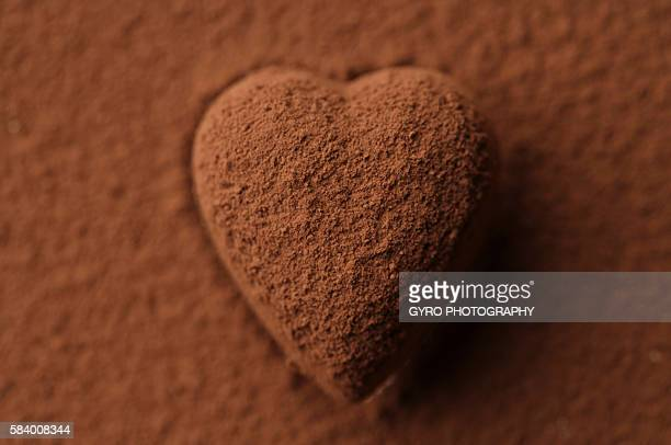 Chocolate heart covered in cocoa powder