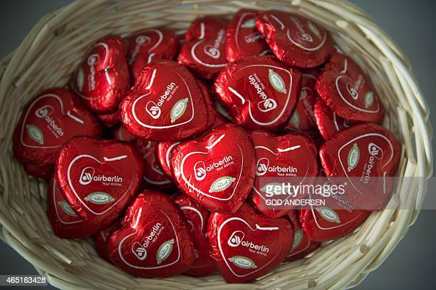 Chocolate hearts reading the name of Germany's secondbiggest airline Air Berlin are on offer during a press conference of the company on March 3 2015...