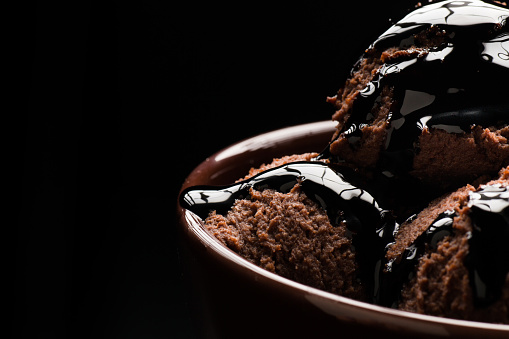 Chocolate Ice cream on a black background - gettyimageskorea