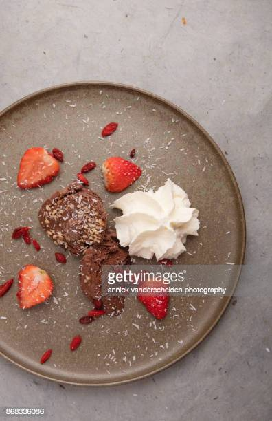 Chocolate ice cream, strawberries, whipped cream, goji and grated coconut.