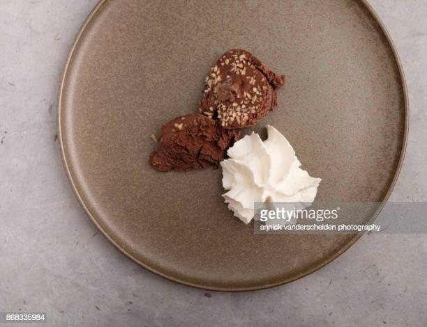 Chocolate ice cream with hazelnut and whipped cream.