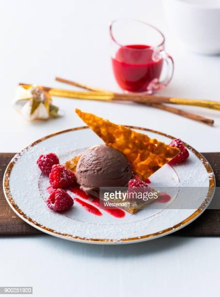 Chocolate icecream with raspberry and pastry
