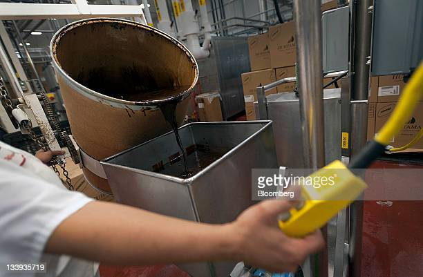 Chocolate is added to ice cream at Turkey Hill LP's production facility in Contestoga Pennsylvania US on Monday Nov 21 2011 Turkey Hill a subsidiary...