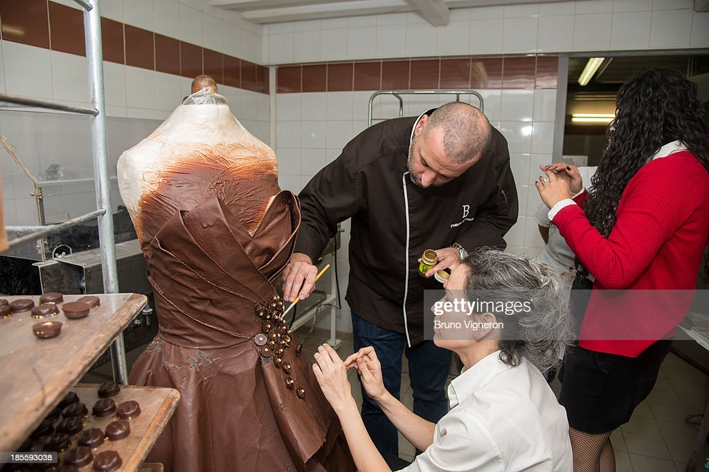 Chocolate maker Philippe Bernachon and designer Florencia Soerensen collaborate to create a chocolate dress on October 22, 2013 in Lyon, France. The six kilogram chocolate dress is made from golden leafs and savage silk and is to be worn by former professional tennis player Marion Bartoli at the Paris chocolate trade show 'Salon du Chocolat' on October 29, 2013 at Porte de Versailles.