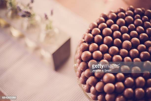 chocolate maltball cake - greedy smith stock pictures, royalty-free photos & images