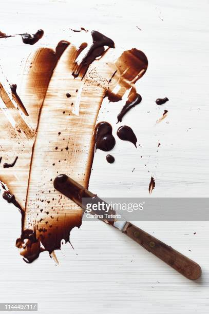 chocolate mess on a table - imperfection stock pictures, royalty-free photos & images
