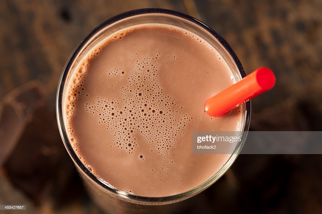 Chocolate milk on a glass with red straw : Stock Photo
