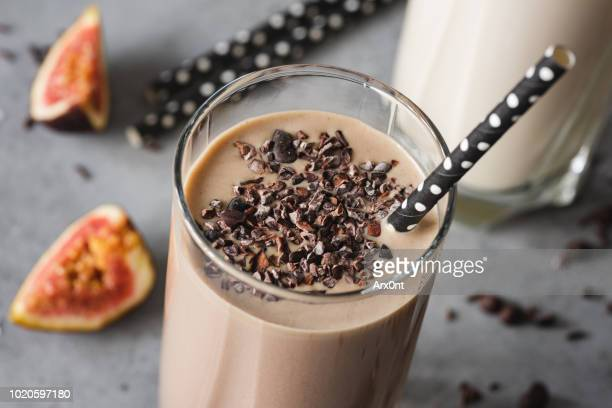 chocolate milkshake closeup view - protein drink stock pictures, royalty-free photos & images