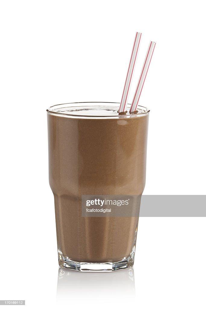 Chocolate milkshake glass against white background : Stock Photo
