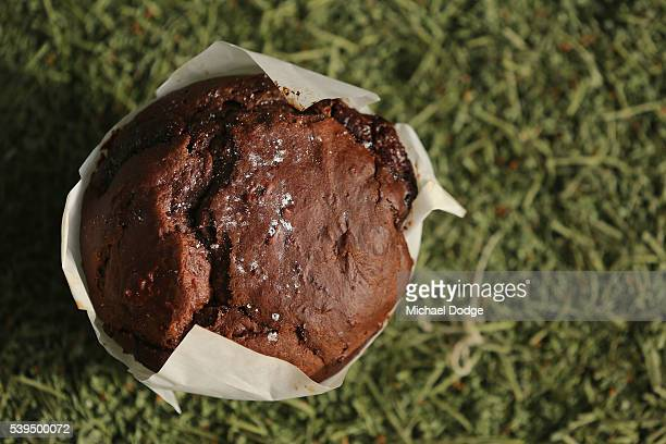 A chocolate muffin given to Andrejs Everitt of the Blues by teammate Ed Curnow is about to be consumed before warm up during the round 12 AFL match...