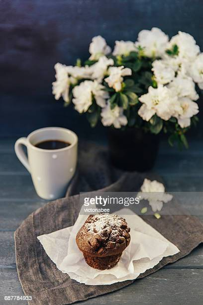Chocolate Muffin with coffee and flowers