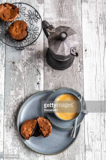 chocolate muffin with liquid chocolate on plate with coffee cup - chocolate cake above stock pictures, royalty-free photos & images